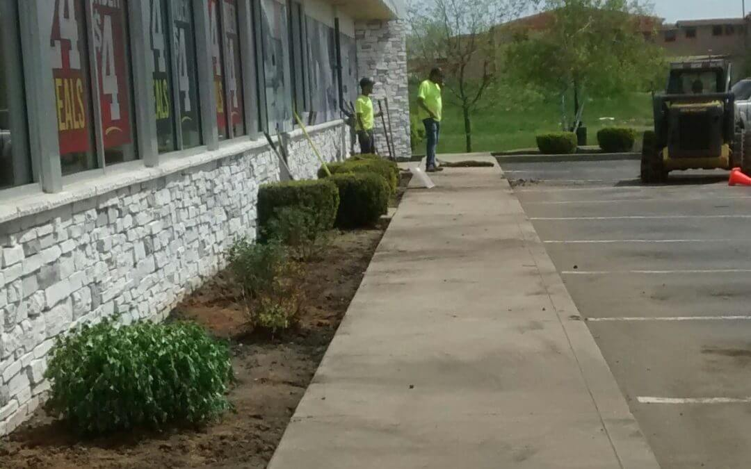 Landscaping team mid project at a local Steak and Shake